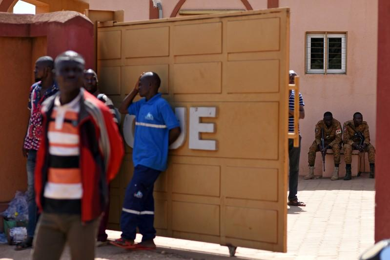 Family members of victims of an attack on a road leading to the Boungou mine, operated by Canadian gold miner Semafo, wait outside a morgue in Ouagadougou