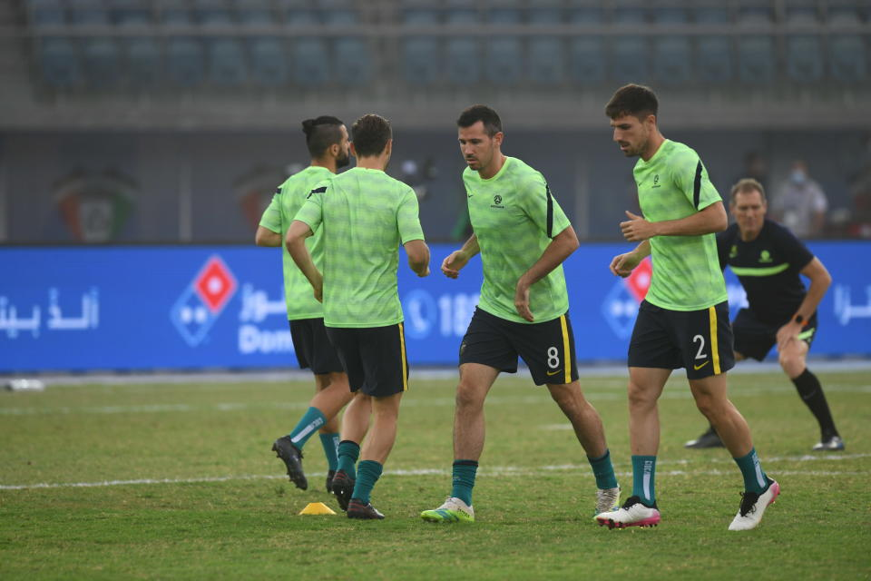 fight for the ball during the World Cup 2022 Group B qualifying soccer match between Nepal and Australia in Kuwait City, Kuwait, Friday. June 11, 2021. (AP Photo/Jaber Abdulkhaleg)