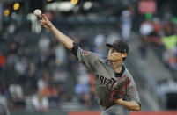 Arizona Diamondbacks starting pitcher Clay Buchholz works in the first inning of a baseball game against the San Francisco Giants, Tuesday, Aug. 28, 2018, in San Francisco. (AP Photo/Eric Risberg)
