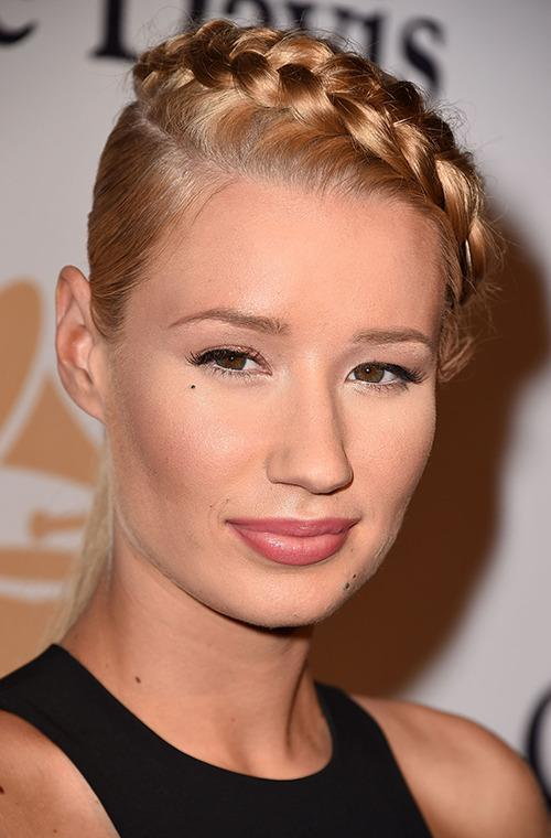 We love Australian recording artist Iggy Azalea's peach-tinted look and blonde braid she sported at a pre-Grammy event in LA this week.