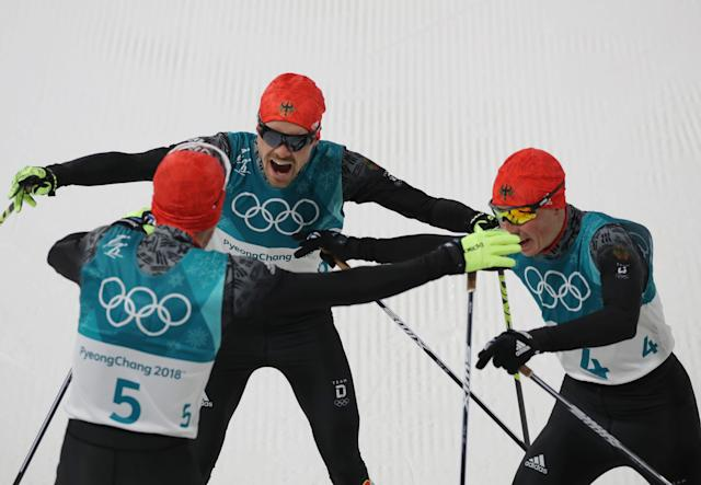 Nordic Combined Events - Pyeongchang 2018 Winter Olympics - Men's Individual 10 km Final - Alpensia Cross-Country Skiing Centre - Pyeongchang, South Korea - February 20, 2018 - Gold medalist, Johannes Rydzek of Germany, silver medalist, Fabian Riessle of Germany and bronze medalist Eric Frenzel of Germany celebrate.