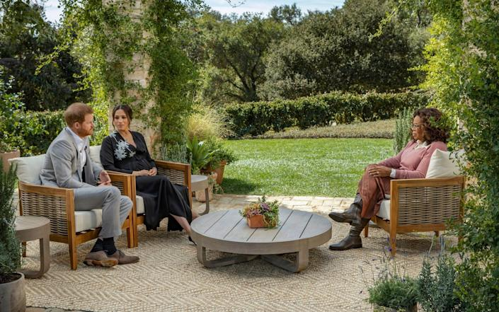 The Duke and Duchess of Sussex sat in a beautiful garden during their interview with Oprah Winfrey - Joe Pugliese/Harpo Productions/PA