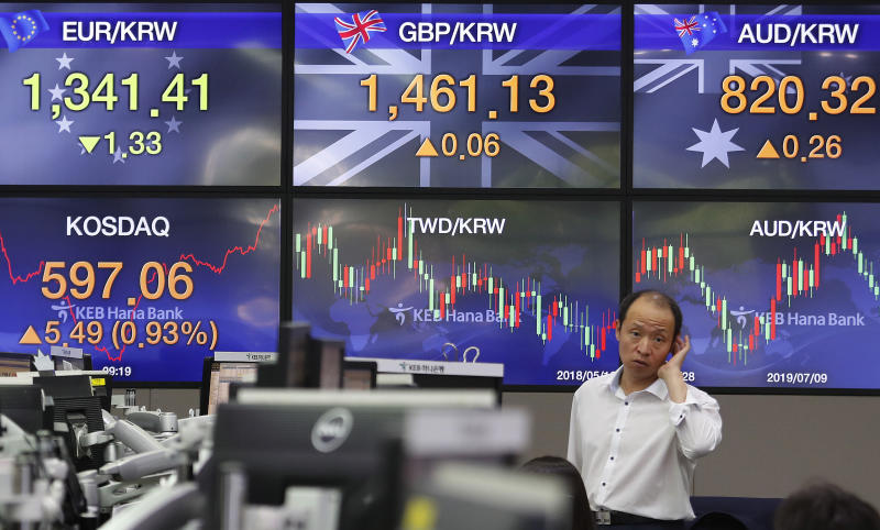 A currency trader works at the foreign exchange dealing room of the KEB Hana Bank headquarters in Seoul, South Korea, Monday, Aug. 19, 2019. Asian shares were higher Monday, as investors continue to rejigger their read on President Donald Trump's trade war and growing worries about slowing economies around the world.(AP Photo/Ahn Young-joon)