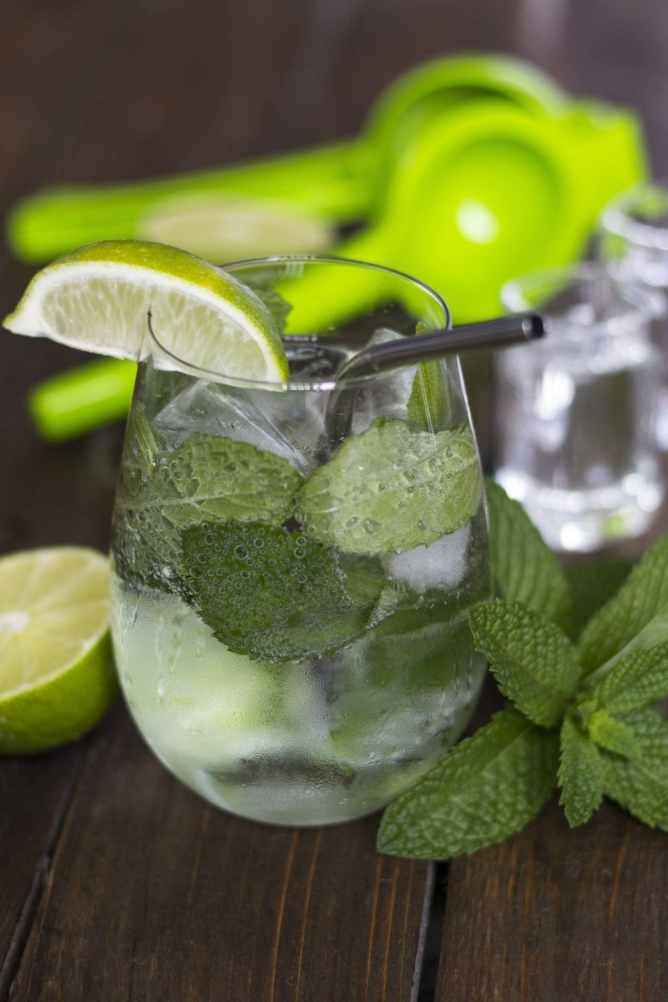 """<p>On a warm spring day, mojitos can be incredibly refreshing — but they're also often loaded with sugar and calories. Luckily, this keto mojito recipe from <a href=""""https://www.tasteaholics.com/recipes/drinks/keto-mojito-low-carb-sugar-free/"""" rel=""""nofollow noopener"""" target=""""_blank"""" data-ylk=""""slk:Tasteaholics"""" class=""""link rapid-noclick-resp"""">Tasteaholics</a> swaps out sugar with a tablespoon of the low-calorie sweetener<a class=""""link rapid-noclick-resp"""" href=""""https://amzn.to/2E2RKLL"""" rel=""""nofollow noopener"""" target=""""_blank"""" data-ylk=""""slk:erythritol""""> erythritol</a>. This cocktail has only 140 calories and contains only 3 grams of carbs.</p>"""