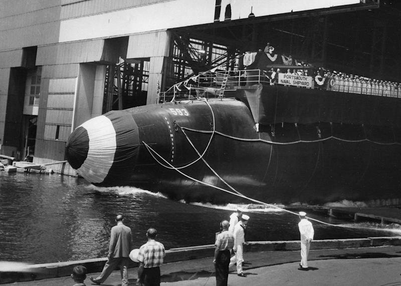 FILE- In this July 9, 1960 handout file photo provided by the U.S. Navy, the nuclear-powered submarine USS Thresher is launched at the Portsmouth Naval Shipyard in Kittery, Maine. Fifty years ago 129 men lost their lives when the sub sank during deep-dive testing off Cape Cod. The deadliest submarine disaster in U.S. history delivered a blow to national pride during the Cold War and became the impetus for safety improvements. (AP Photo/U.S. Navy, file)