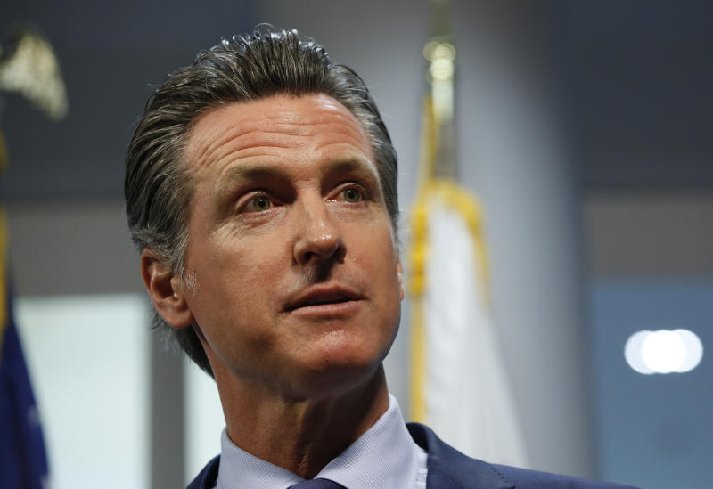 FILE - In this Friday, April 12, 2019, file photo, California Gov. Gavin Newsom answers a reporter's question about a report he presented concerning the worsening wildfires in the state, during a news conference, in Rancho Cordova, Calif. Newsom announced Friday, Dec. 13, that he has rejected a bankruptcy reorganization plan that Pacific Gas and Electric reached just last week with thousands of wildfire victims, including a $13.5 billion settlement.  (AP Photo/Rich Pedroncelli, File)