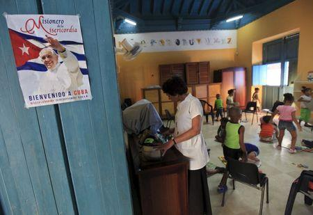 A picture of Pope Francis is seen on a door at the Father Usera daycare center in Havana, September 4, 2015. REUTERS/Enrique de la Osa