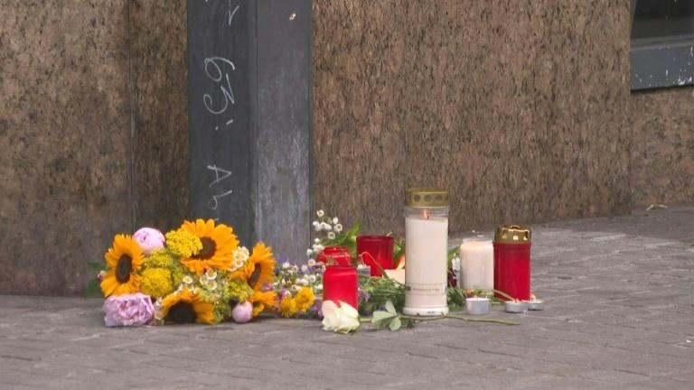 Flowers, candles at scene of deadly knife attack in Germany