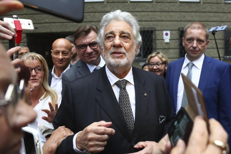 "FILE - In this Aug. 25, 2019 file photo, Placido Domingo talks to fans at the ""Festspielhaus"" opera house after he performed ""Luisa Miller"" by Giuseppe Verdi in Salzburg, Austria. The cancellation Tuesday, Sept. 24, 2019, of Domingo's Metropolitan Opera performance in ""Macbeth"" means the singer, who has been accused by multiple women of sexual misconduct, has only a few U.S. shows scheduled, all set for California in 2020. Domingo has said he strongly disputes the allegations made against him. (AP Photo/Matthias Schrader, File)"