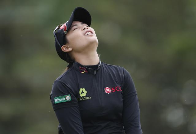 Moriya Jutanugarn of Thailand reacts after driving on the fourth tee during the final round of the Dow Great Lakes Bay Invitational golf tournament, Saturday, July 20, 2019, in Midland, Mich. (AP Photo/Carlos Osorio)