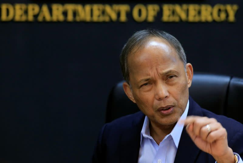 Philippine Department of Energy (DOE) Secretary Alfonso Cusi gestures during a Reuters interview at the DOE headquarters in Taguig city, Metro Manila