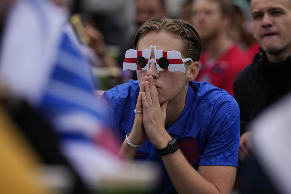 An England fan watches the Euro 2020 round of 16 soccer championship match between England and Germany being played at London's Wembley stadium, at fan zone in central Trafalgar Square in London, Tuesday, June 29, 2021. (AP Photo/Matt Dunham)