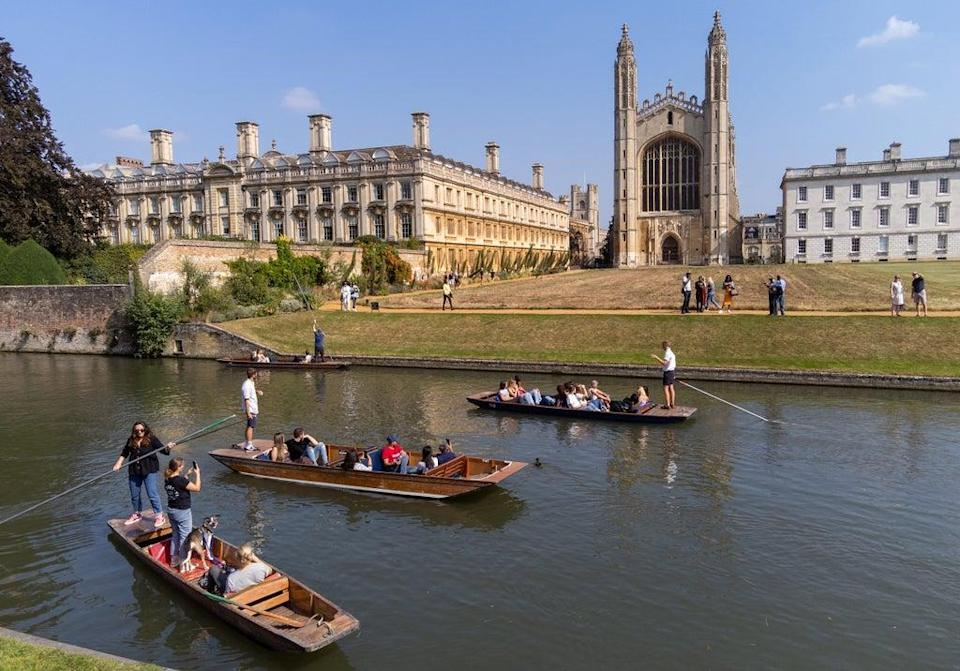 People punt past King's College along the River Cam in Cambridge. Picture date: Sunday September 5, 2021. (PA Wire)