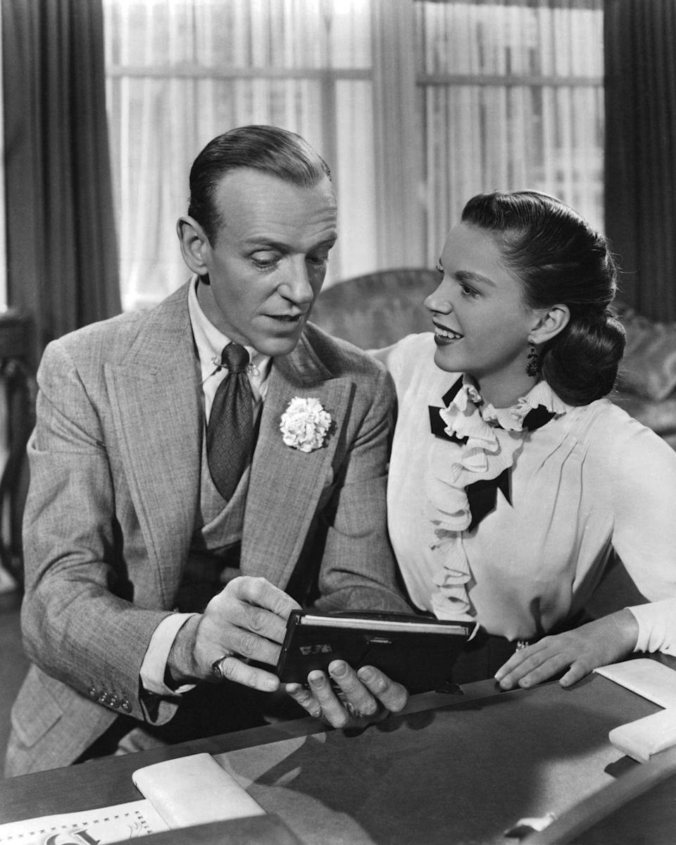 """<p>When Gene Kelly broke his ankle, the legendary Fred Astaire became Judy's leading man in <u><a href=""""https://www.amazon.com/Easter-Parade-Judy-Garland/dp/B002WG7XDM/ref=sr_1_1?crid=1HT1PU5XMOHYX&keywords=easter+parade+dvd&qid=1562448935&s=gateway&sprefix=easter+parade%2Caps%2C136&sr=8-1&tag=syn-yahoo-20&ascsubtag=%5Bartid%7C10050.g.28612488%5Bsrc%7Cyahoo-us"""" rel=""""nofollow noopener"""" target=""""_blank"""" data-ylk=""""slk:Easter Parade"""" class=""""link rapid-noclick-resp""""><em>Easter Parade</em></a></u>, one of Judy's biggest box office triumphs. </p>"""