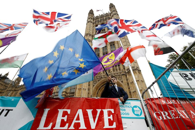 An anti-Brexit protester waves an EU flag outside the Houses of Parliament in London, Britain, October 25, 2019. REUTERS/Henry Nicholls