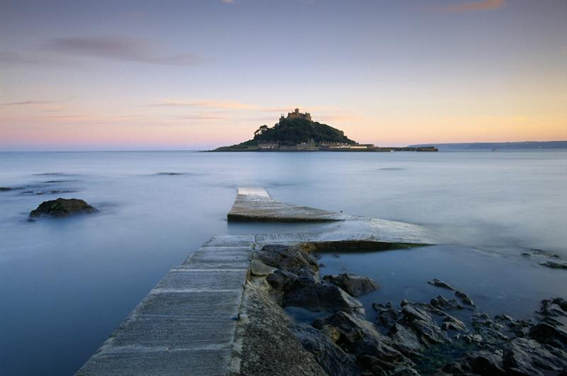The view of St Michael's Mount silhouetted in a pink dawn. [Photo: National Trust]