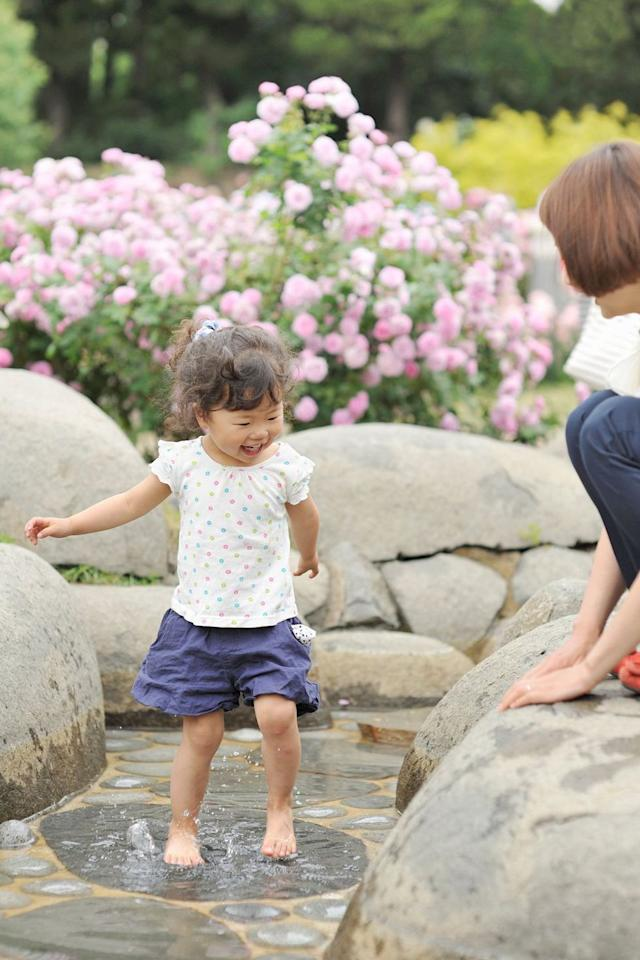 """<p>Venture outside of your own backyard to a nearby park where your kids can play with other children their own age, jump around in water fountains, and soak in all the Vitamin D possible  -  just don't forget to <a rel=""""nofollow"""" href=""""https://www.womansday.com/health-fitness/womens-health/advice/g788/best-sunscreens/"""">apply sunscreen first</a>. </p>"""
