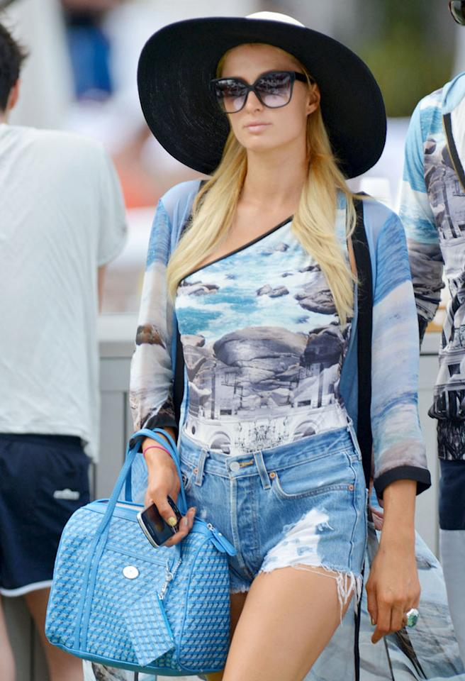 88094, MIAMI, FLORIDA -Saturday December 8, 2012.  Paris Hilton and her toy boy River Viiperi matched attire as they spent some time poolside in Miami in an asymmetrical one piece bathing suit with a cover up and jean shorts and River wearing a sweater version of Paris ensemble.  Photograph: © Thibault Monnier/Brett Kaffee, PacificCoastNews.com   **FEE MUST BE AGREED PRIOR TO USAGE** **E-TABLET/IPAD & MOBILE PHONE APP PUBLISHING REQUIRES ADDITIONAL FEES** LOS ANGELES OFFICE:  1 310 822 0419 LONDON OFFICE:  44 20 8090 4079