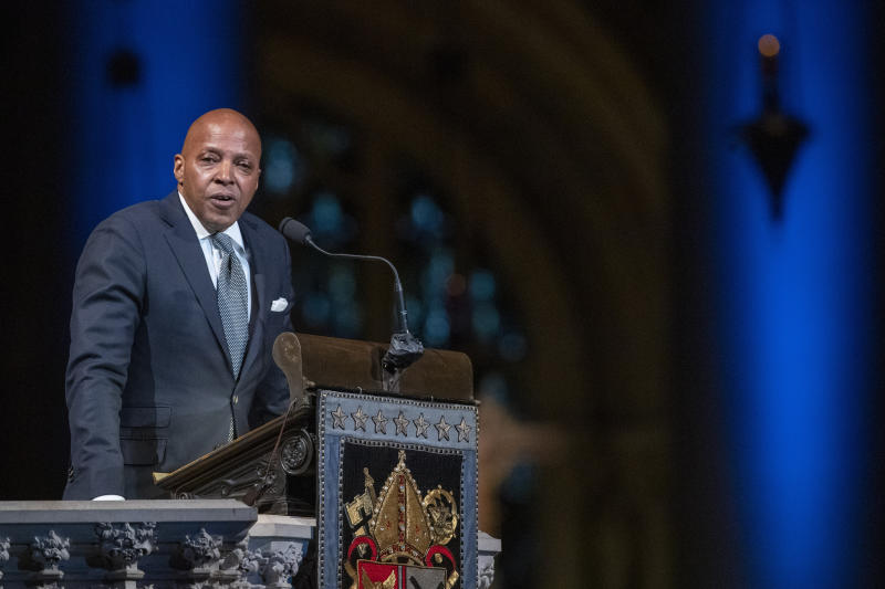 Erroll McDonald speaks during the Celebration of the Life of Toni Morrison, Thursday, Nov. 21, 2019, at the Cathedral of St. John the Divine in New York. Morrison, a Nobel laureate, died in August at 88. (AP Photo/Mary Altaffer)