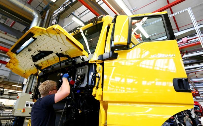 A man works at the assembly line in the truck production plant of truck and bus-maker MAN AG in Munich
