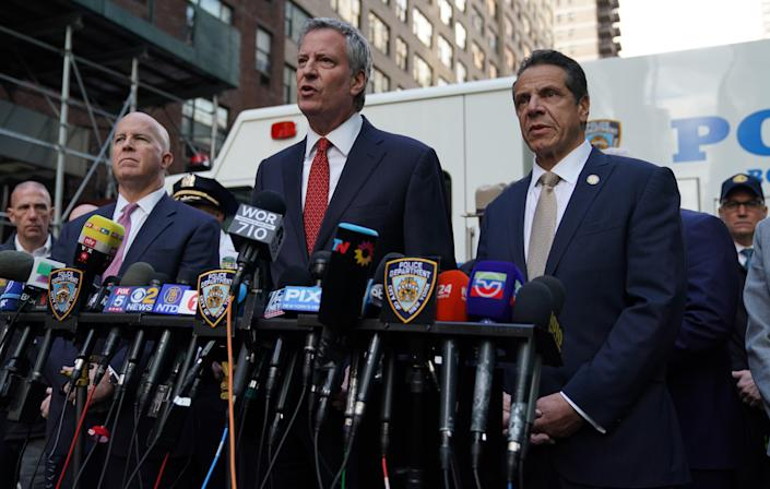 <p>New York City Police Commissioner James ONeil, New York City Mayor Bill de Blasio and New York Governor Andrew Cuomo attend a news conference outside the Time Warner Building on October 24, 2018, after an explosive device was delivered to CNN's New York bureau. (Photo: Timothy A. Clary/AFP/Getty Images) </p>