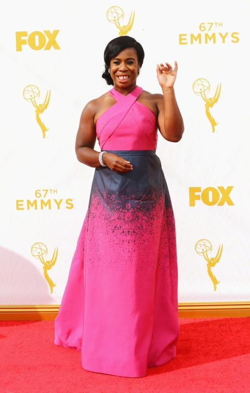 <p>Uzo Aduba combined ombré and splatter paint into one with her Johnathan Cohen dress. The hot pink and black dress with a halter neck was like a Rorschach test for Barbie — you decide if that's a good or bad thing. </p>