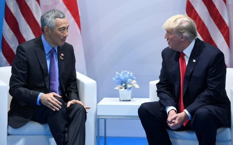 US President Donald Trump, right, and Singapore's Prime Minister Lee Hsien Loong hold a meeting on the sidelines of the G20 Summit in Hamburg, Germany, July 8, 2017