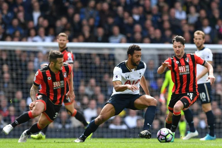 Tottenham Hotspur's Mousa Dembele vies with Bournemouth's Jack Wilshere (L) and Adam Smith (R) during their match at White Hart Lane in London, on April 15, 2017