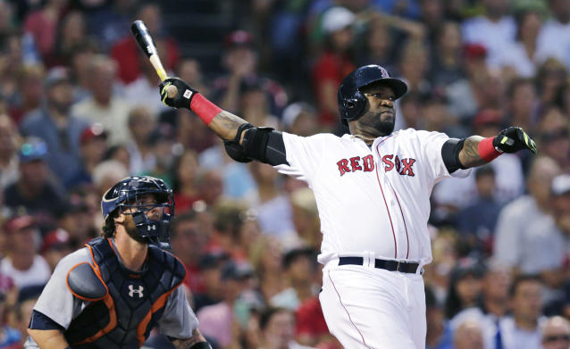 FILE - In this July 26, 2016, file photo, Boston Red Sox designated hitter David Ortiz and Detroit Tigers catcher Jarrod Saltalamacchia watch the flight of Ortiz's three-run home run during the third inning of a baseball game at Fenway Park, in Boston. Ortiz was back in Boston for medical care after authorities said the former Red Sox slugger affectionately known as Big Papi was ambushed by a gunman at a bar in his native Dominican Republic. A plane carrying the 43-year-old retired athlete landed Monday night, June 10, 2019, after a flight from the Dominican Republic, the team said. (AP Photo/Charles Krupa, File)