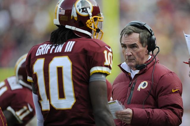 Washington Redskins head coach Mike Shanahan ranks with quarterback Robert Griffin III during the first half of an NFL football game against the Philadelphia Eagles in Landover, Md., Sunday, Nov. 18, 2012. (AP Photo/Nick Wass)