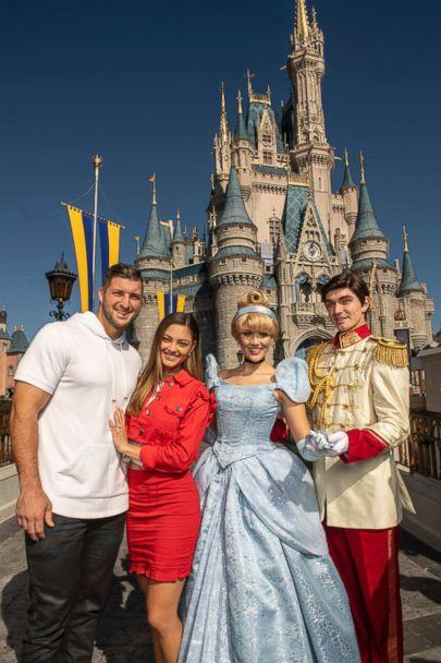 PHOTO: Professional athlete and sports analyst Tim Tebow and fiancee Demi-Leigh Nel-Peters strike a pose with Cinderella and Prince Charming at Magic Kingdom Park at Walt Disney World Resort in Lake Buena Vista, Fla., Friday, Jan. 11, 2019. (Kent Phillips, Photographer )