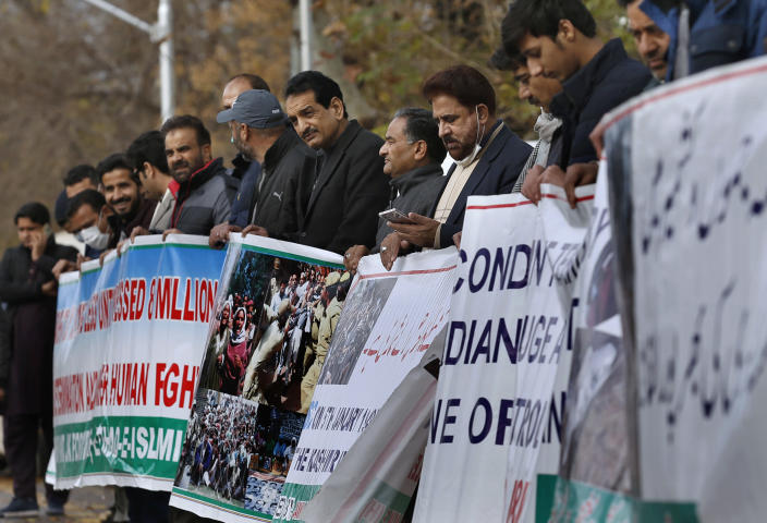 """Supporters of the civil society group, Jammu Kashmir Forum, take part in a demonstration to mark, The Right to Self-determination Day,"""" in Islamabad, Pakistan, Tuesday, Jan. 5, 2020. Dozens of Kashmiris activists living Pakistan rallied in the capital, Islamabad, urging the United Nations to ensure the provision of right of self-determination to them as per its decades-old resolution on Kashmir. (AP Photo/Anjum Naveed)"""