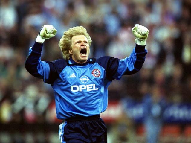 FILE PHOTO: Bayern Munich goalkeeper Oliver Kahn celebrates winning the Champions League after a penalty shootout against Valencia at the San Siro stadium, Milan.