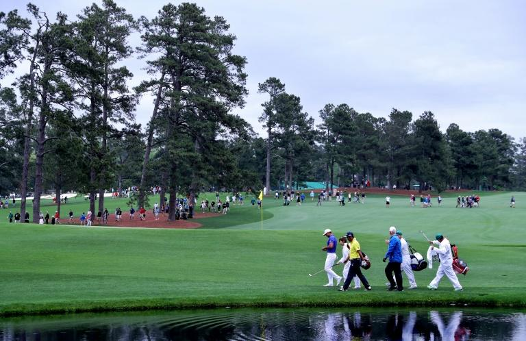 Jason Day of Australia, Yuta Ikeda of Japan and Sandy Lyle of Scotland, seen on the 16th hole during a practice round prior to the start of the 2017 Masters Tournament, at Augusta National Golf Club in Georgia, on April 3