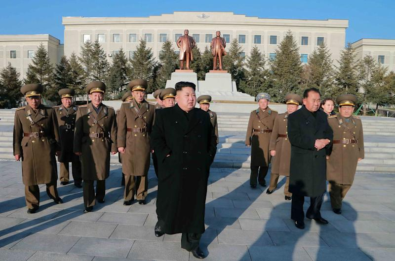 Undated photo released on January 13, 2015 shows North Korean leader Kim Jong-Un during an inspection of the Air and Anti-Air Force of the Korean People's Army command in North Korea (AFP Photo/)