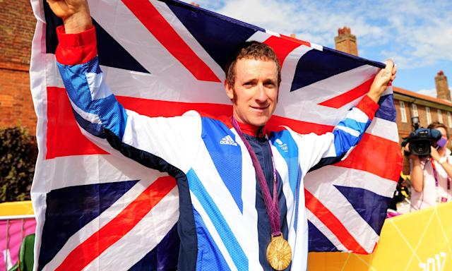 Bradley Wiggins celebrates his gold medal in the time trial at the London 2012 Olympics, which came just weeks after his Tour de France triumph.