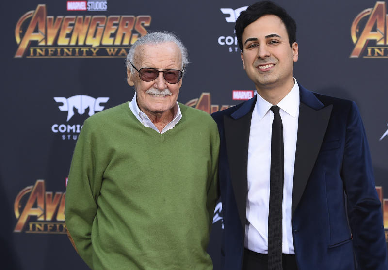 "FILE - In this April 23, 2018, file photo, Stan Lee, left, and Keya Morgan arrive at the world premiere of ""Avengers: Infinity War"" in Los Angeles. Morgan, the former business manager of Lee has been arrested on elder abuse charges involving the late comic book icon. Los Angeles police say Morgan was taken into custody in Arizona early Saturday, May 25, 2019, on an outstanding arrest warrant. Morgan was charged earlier this month with felony allegations of theft, embezzlement, forgery or fraud against an elder adult, and false imprisonment of an elder adult. (Photo by Jordan Strauss/Invision/AP, File)"