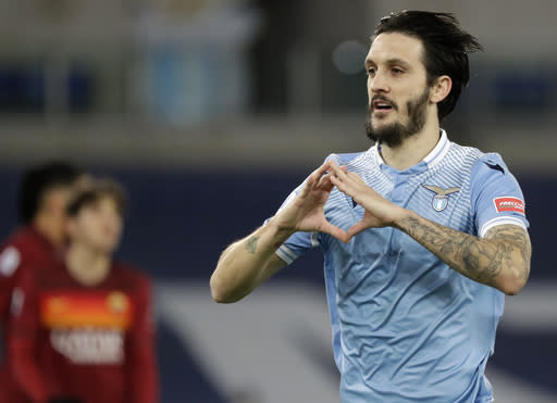 Lazio's Luis Alberto celebrates after scoring his sides second goal during the Serie A soccer match between Lazio and Roma, at Rome's Olympic Stadium, Friday, Jan. 15, 2021. (AP Photo/Andrew Medichini)