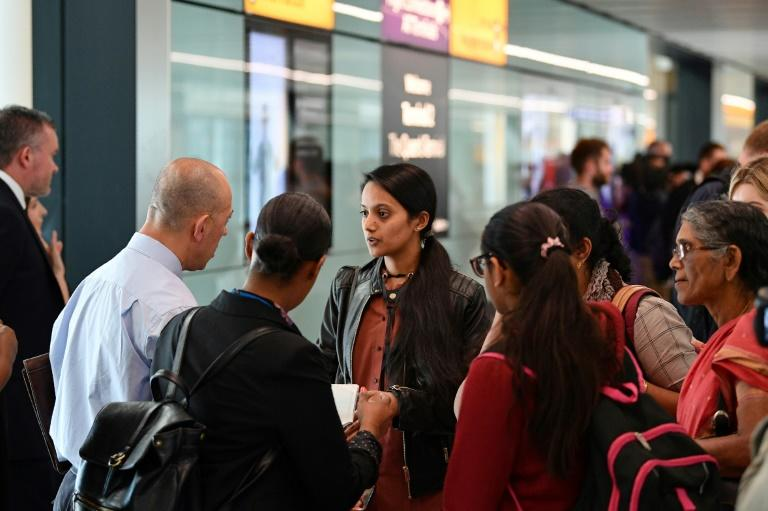 Some of those arriving at Heathrow to be greeted by the taskforce welcomed the action (AFP Photo/Daniel LEAL-OLIVAS)