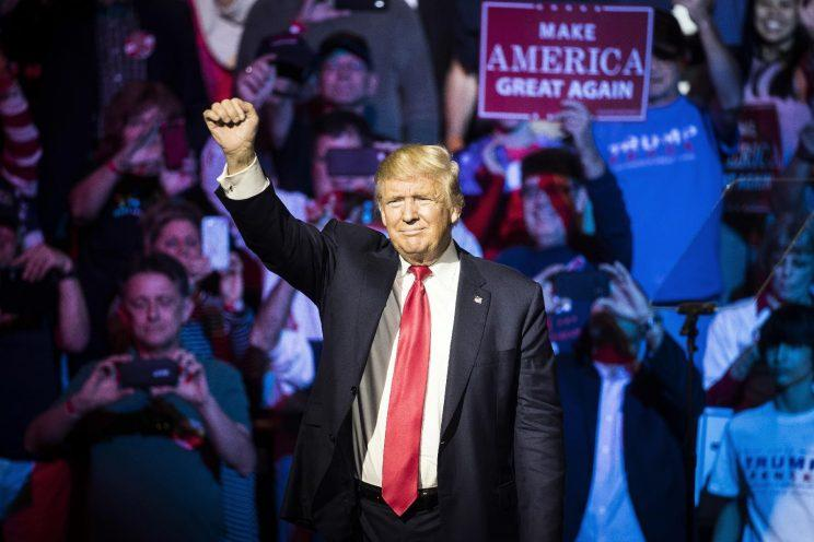 Republican presidential candidate Donald Trump waves to the crowd during a campaign rally, Thursday, Oct. 13, 2016, in Cincinnati. (Photo: John Minchillo/AP)