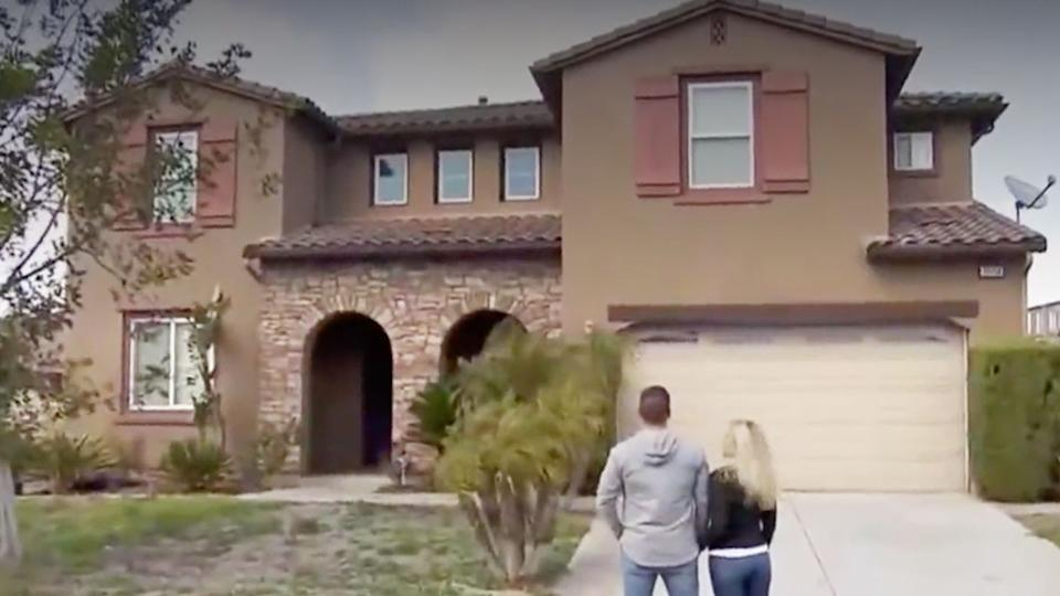 Tracie and Myles Albert outside their new home.