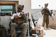 US Central Command Public Affairs issued photos of troops caring for Afghan children amid evacuation efforts at Hamid Karzai International Airport in Kabul