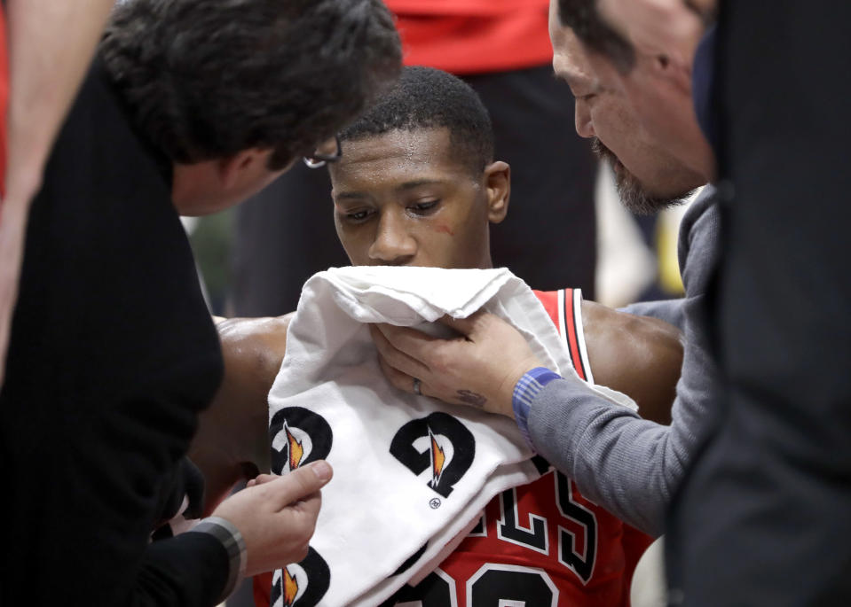 Chicago Bulls' Kris Dunn is treated by the medical staff after hitting his face on the floor after a dunk against the Golden State Warriors Wednesday, Jan. 17, 2018, in Chicago. (AP)