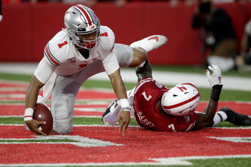 Ohio State quarterback Justin Fields (1) scores a touchdown next to Nebraska linebacker Mohamed Barry (7) during the first half of an NCAA college football game in Lincoln, Neb., Saturday, Sept. 28, 2019. (AP Photo/Nati Harnik)