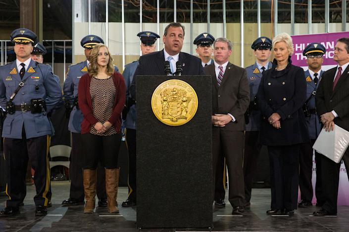 EAST RUTHERFORD, NJ - JANUARY 29:  New Jersey Gov. Chris Christie (6th L) speaks at a press conference announcing new objectives to crack down on human and sex trafficking throughout the state of New Jersey, inspired in part by the upcoming Super Bowl, on January 29, 2014 in East Rutherford, New Jersey. Christie Spoke along side New Jersey Attorney General John Hoffman and Cindy McCain, wife of Arizona Senator John McCain. (Photo by Andrew Burton/Getty Images)