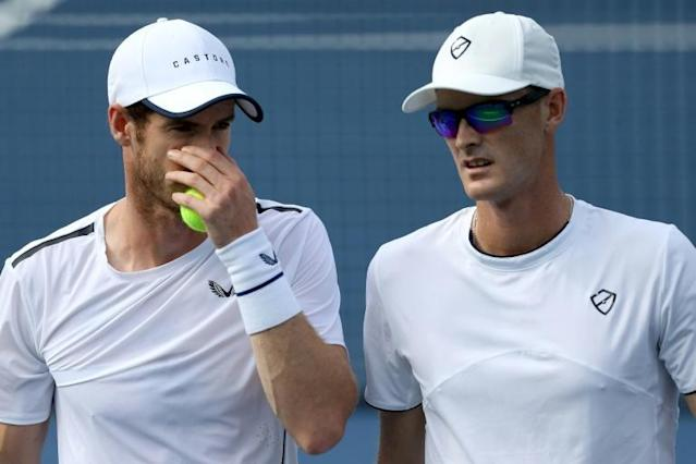 Britain's Andy Murray, left, and brother Jamie Murray advanced to the ATP Washington Open doubles quarter-finals (AFP Photo/Rob Carr)