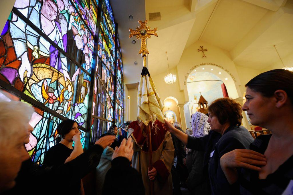 LOS ANGELES, CA:   Parishioners touch and kiss the veil of the cross during a Christmas mass procession at St. Garabed Armenian Apostolic Church. File photo: January 2011