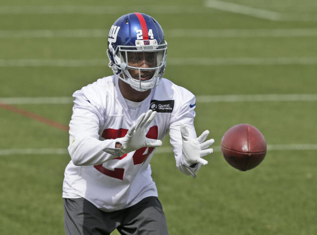FILE - In this April 24, 2018, file photo, New York Giants' Eli Apple catches a ball during NFL football training camp in East Rutherford, N.J. After having a year in which many questioned whether the New York Giants wasted a recent first-round draft pick, Apple is starting to live up to expectations. AP Photo/Seth Wenig, File)