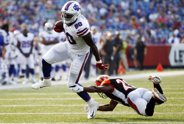 Buffalo Bills tight end Jason Croom (80) leaps over Cincinnati Bengals' KeiVarae Russell (20) during the second half of a preseason NFL football game Sunday, Aug. 26, 2018, in Orchard Park, N.Y. (AP Photo/Jeffrey T. Barnes)