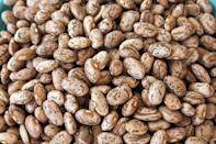 """<p>Of all the beans, pinto beans are the most widely produced bean in the U.S., according to the Bean Institute. Raw pinto beans have a signature speckled beige and brown look that disappears when cooked for 90 to 120 minutes. <a href=""""https://www.thedailymeal.com/refried-beans-0?referrer=yahoo&category=beauty_food&include_utm=1&utm_medium=referral&utm_source=yahoo&utm_campaign=feed"""" rel=""""nofollow noopener"""" target=""""_blank"""" data-ylk=""""slk:Mexican-style refried beans"""" class=""""link rapid-noclick-resp"""">Mexican-style refried beans</a> are made from pinto beans, as are other dishes from dips to pastas.</p>"""